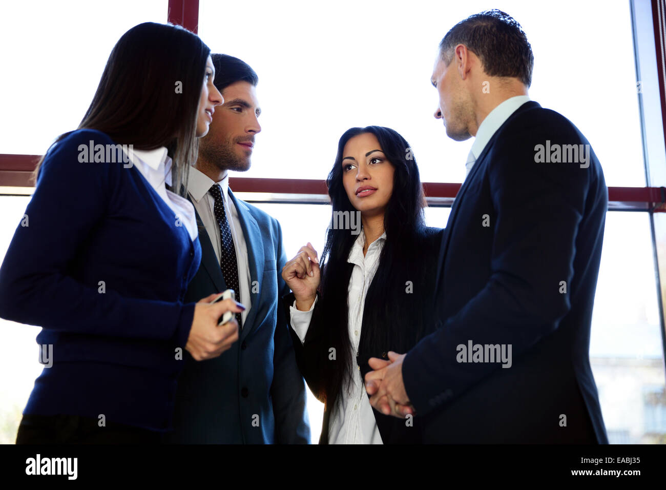 Group of business people talking in the office - Stock Image