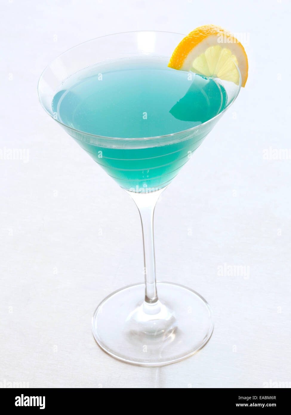 Blue Martini with slice of lemon - Stock Image