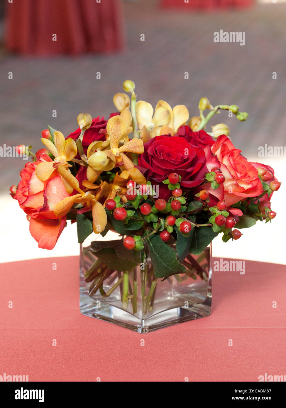 Vase of flowers on table at reception Stock Photo