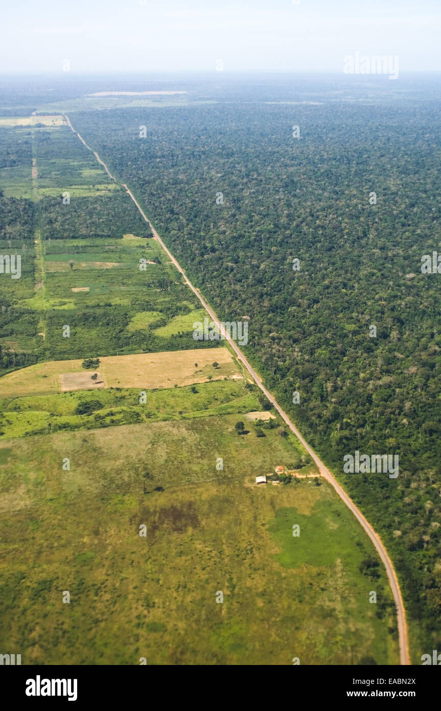 Near Sao Benedito, Para State, Brazil. Aerial view of a road which borders the forest with deforested land on the Stock Photo