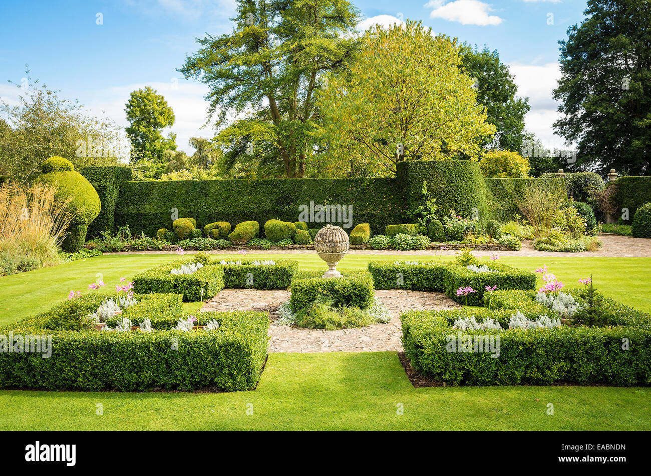 Symmetrical borders and topiary in The Courts garden in UK - Stock Image