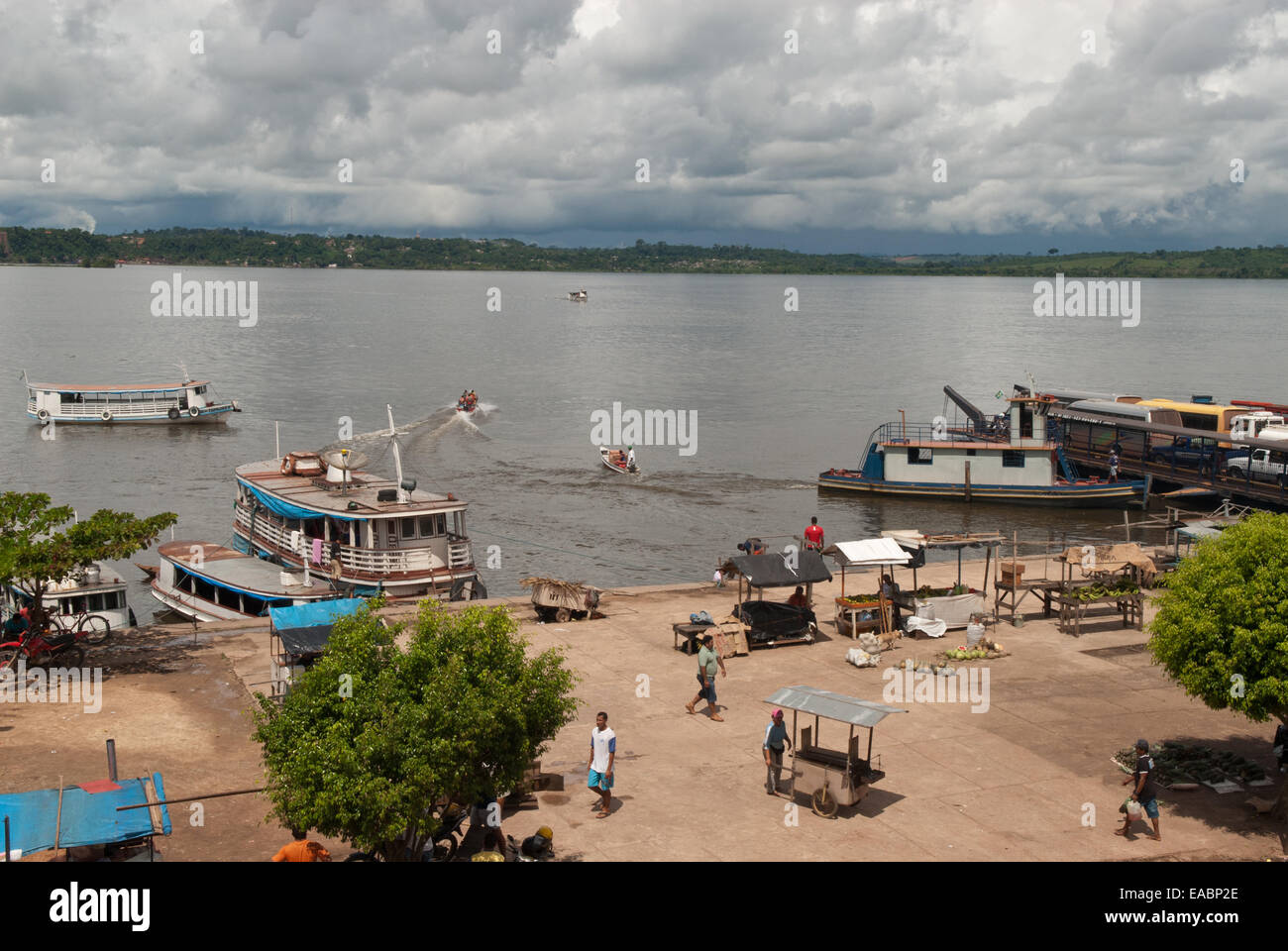 Itaituba, Amazon, Tapajos river, Para State, Brazil. Quay at the port with riverboats, street vendors and a ferry - Stock Image
