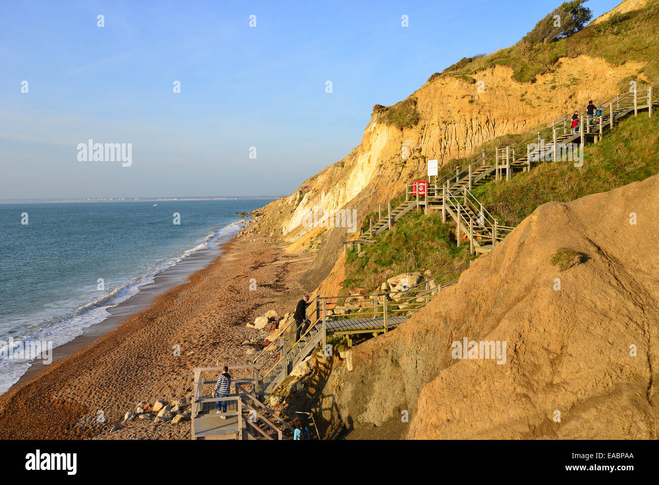 Stairs up from multi-coloured sand cliffs, Alum Bay, Isle of Wight, England, United KingdomStock Photo