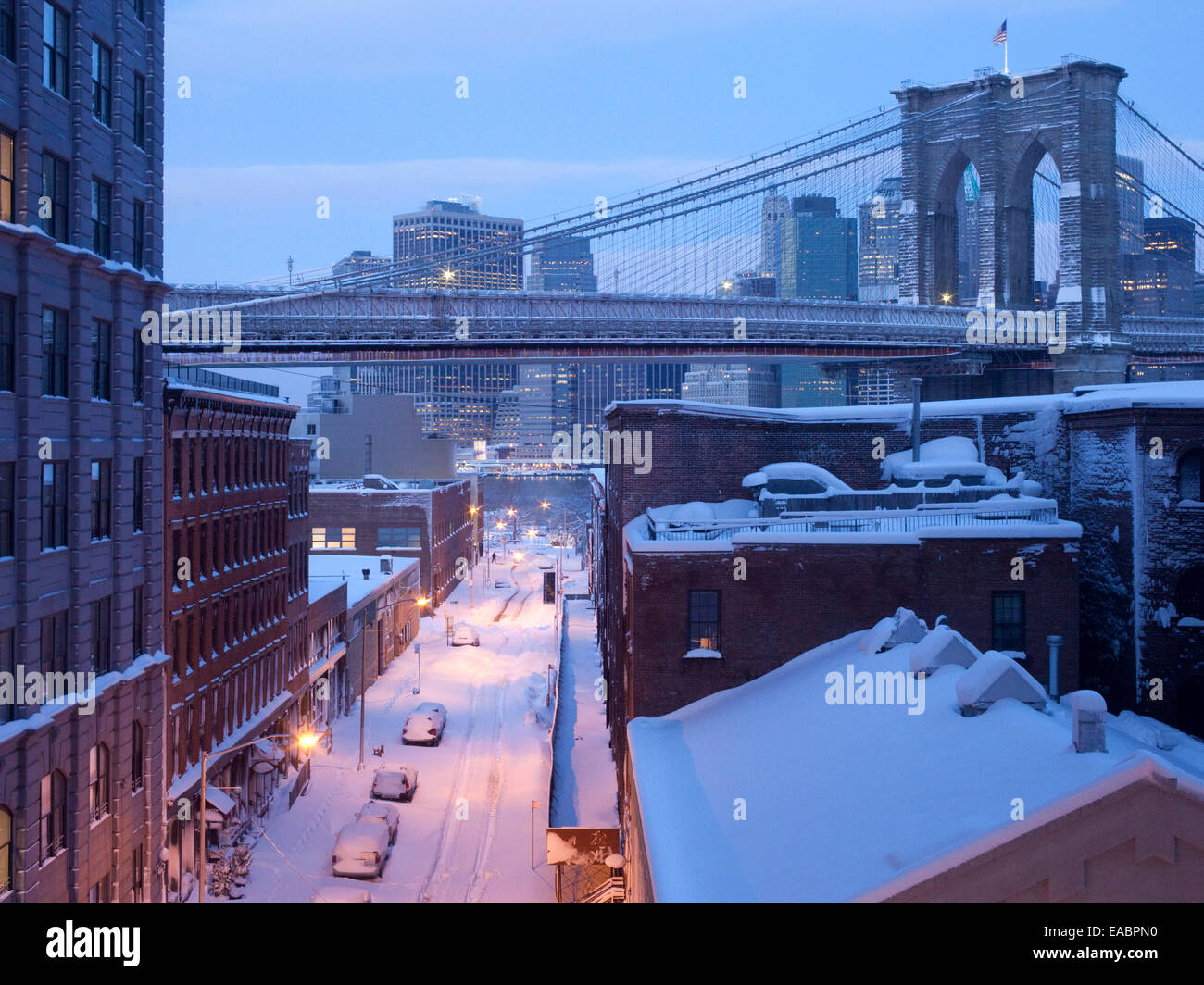 Dumbo, Brooklyn Neighborhood and span of Brooklyn Bridge in early morning just after snow storm. - Stock Image