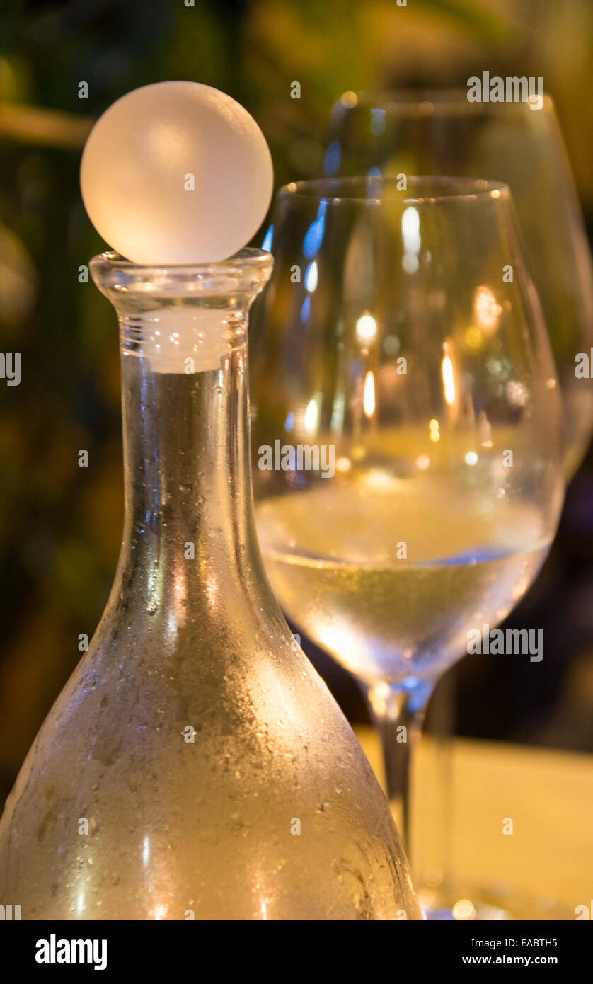 Fresh water, two glasses and a glass bottle - Stock Image