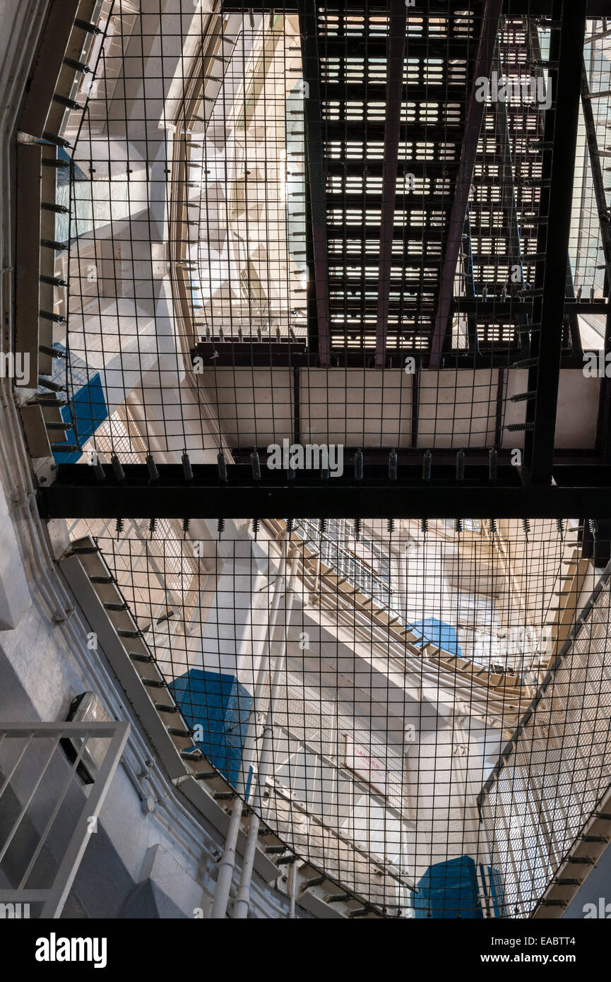 HMP Lancaster Castle, Lancashire, UK. Looking up through the safety mesh in the 'Female Felons' Wing'. - Stock Image
