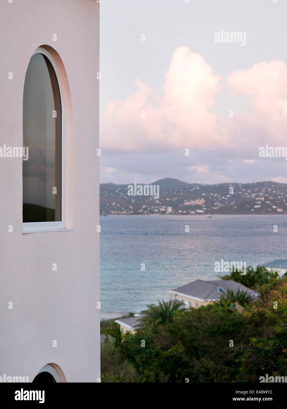 Caribbean bay in St. Thomas with catamaran sailing boat ocean sea sunrise sky war travel vacation - Stock Image