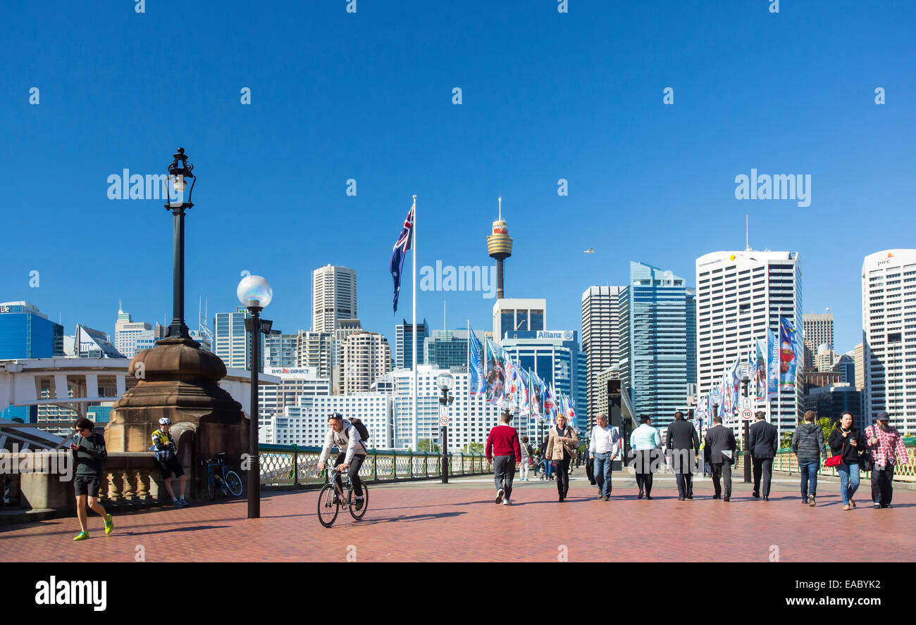 People walking along a promenade in Darling Harbour near Sydney CBD, Sydney, New South Wales, Australia - Stock Image