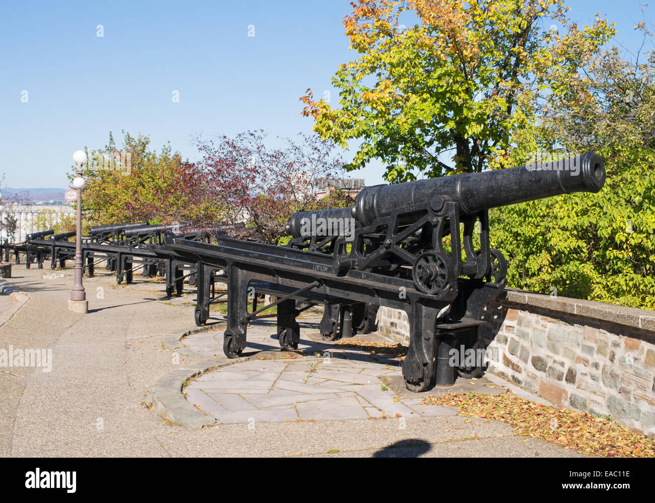 Row of old British cannon mounted on swiveling carriages, part of the Quebec battery, Canada. - Stock Image