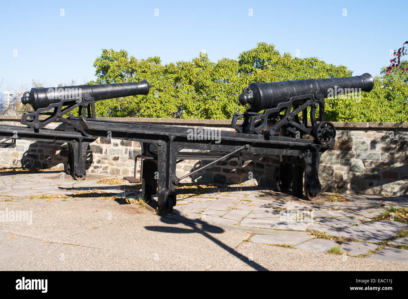 Two old British cannon mounted on swiveling carriages, part of the Quebec battery, Canada. - Stock Image
