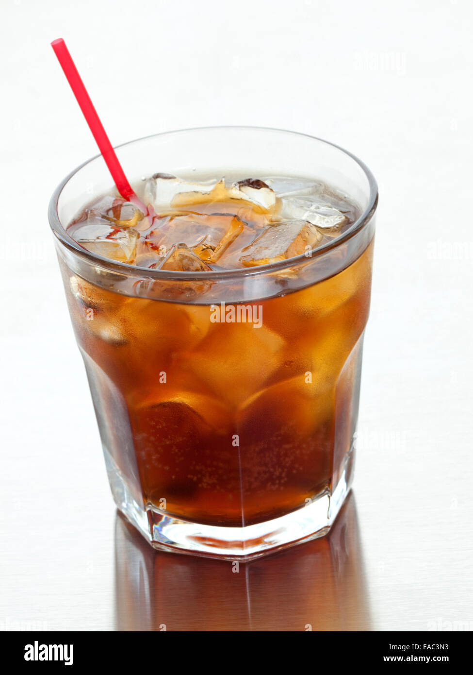 Cola Drink in glass with ice and straw - Stock Image