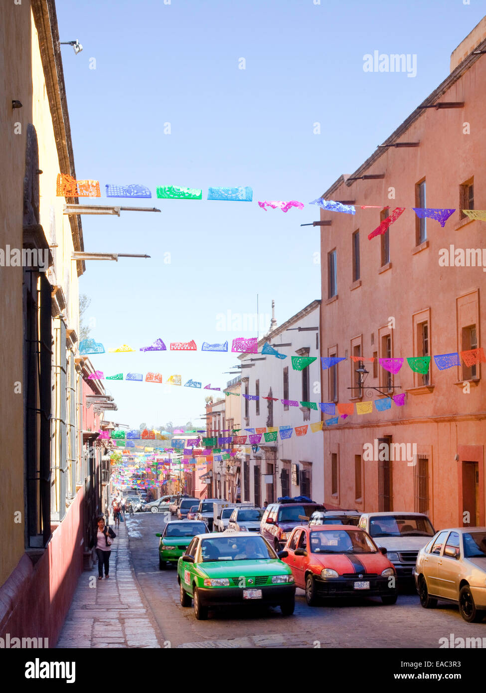 Decorative Paper Streamers over a Mexican Street - Stock Image