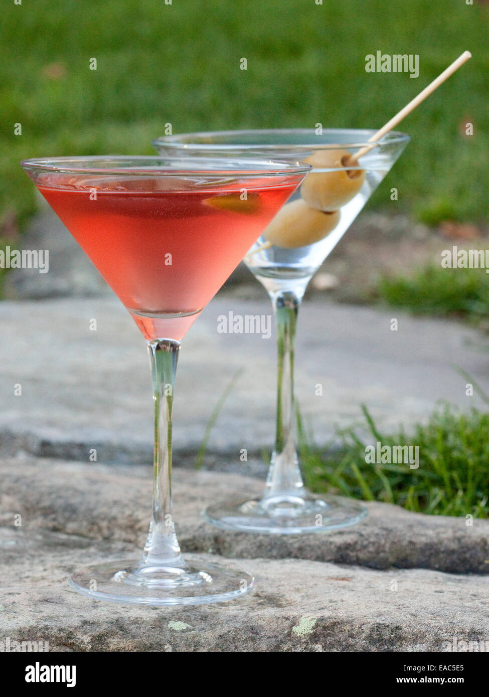 Cosmopolitan and and Martini on stone wall during outdoor reception - Stock Image