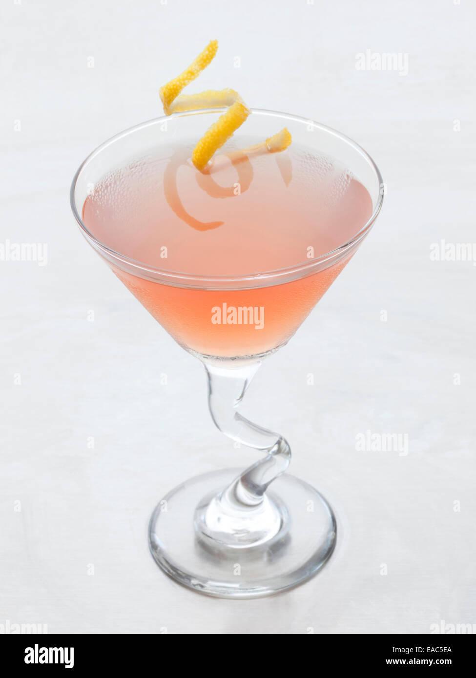 Cosmopolitan with lemon rind garnish - Stock Image