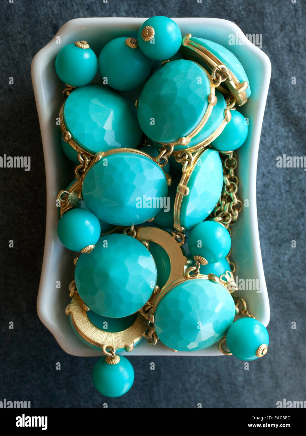 Turquoise Jewelry in dish - Stock Image