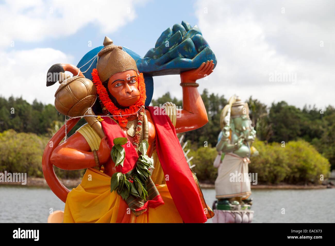 Statues of Hindu gods, Hanuman in the foreground and Ganesha, Grand Bassin Hindu temple, Mauritius - Stock Image
