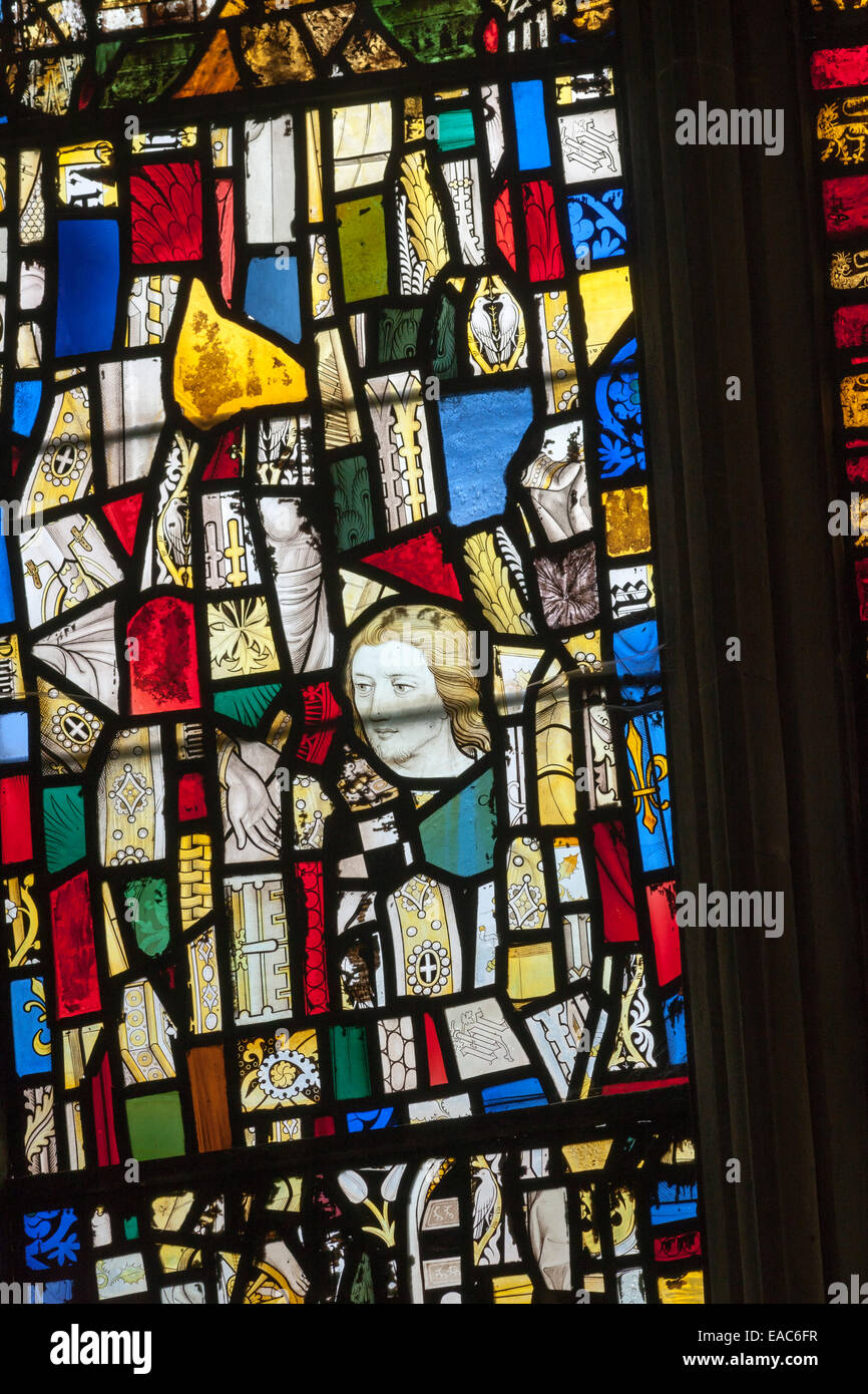 A stained glass window made up from medieval fragments - Stock Image