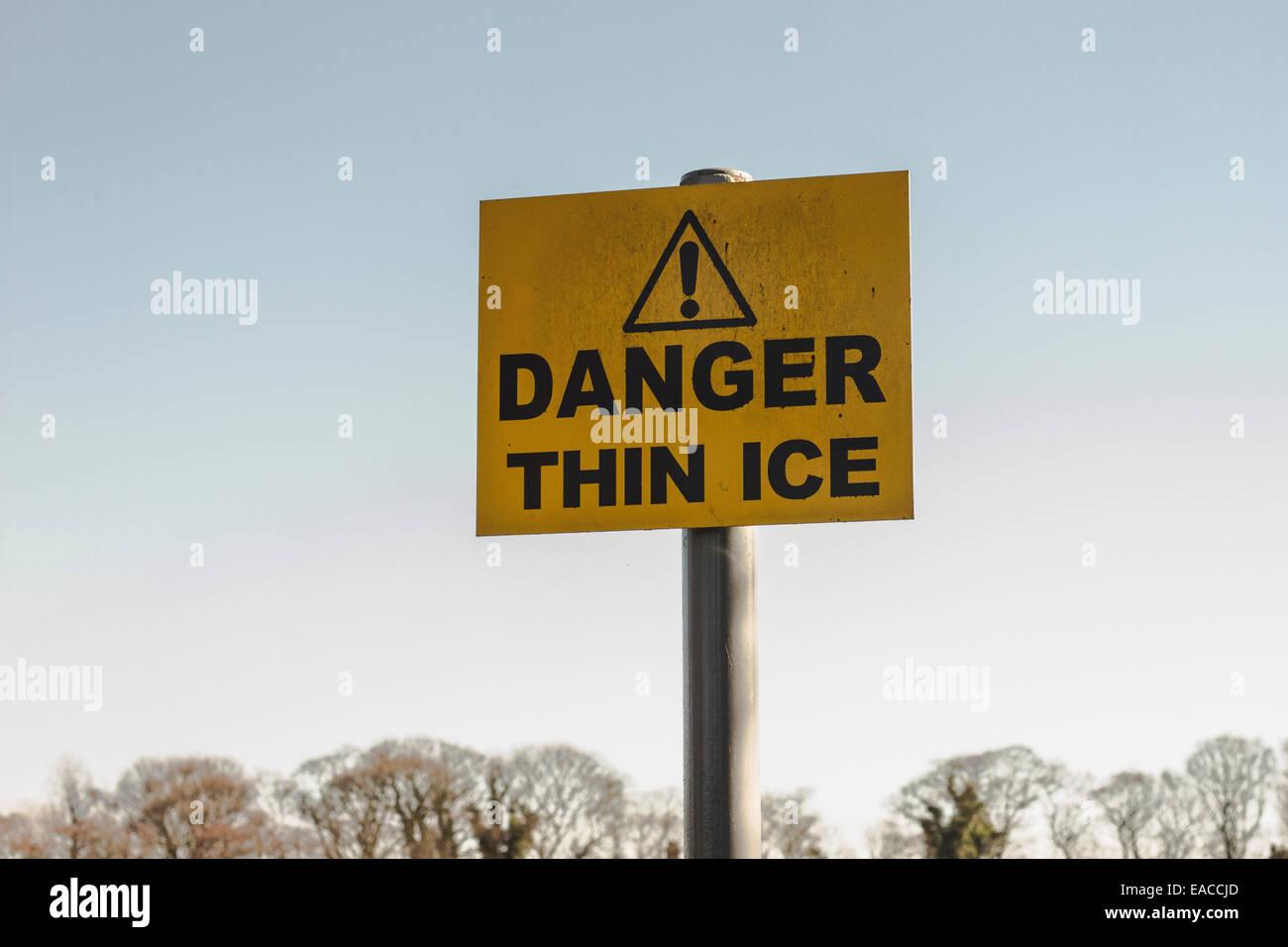 Danger Thin Ice Warning Sign - Stock Image