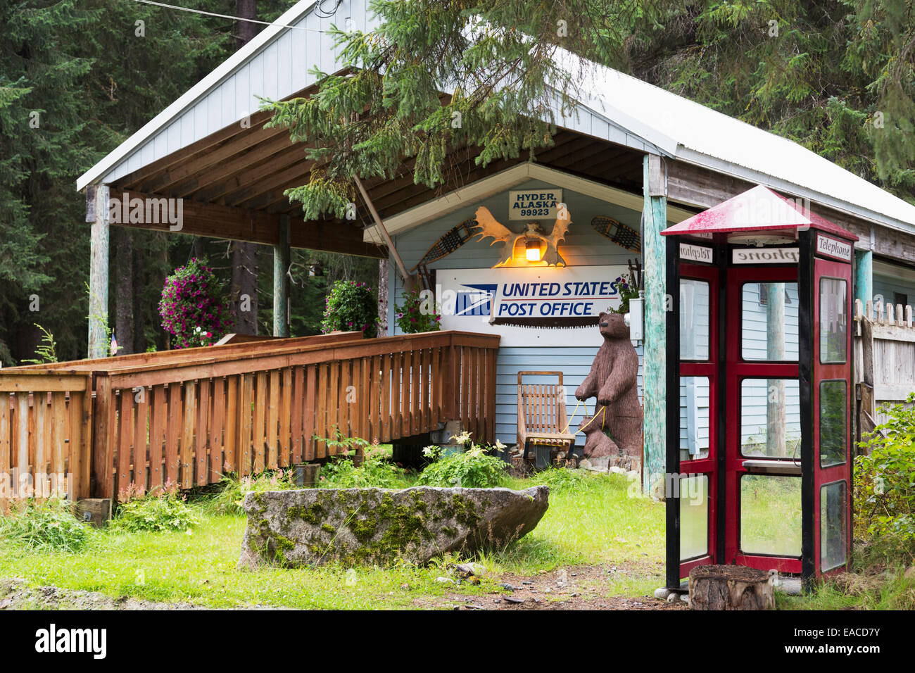 Post office and phone booth; Hyder, Alaska, United States of America - Stock Image