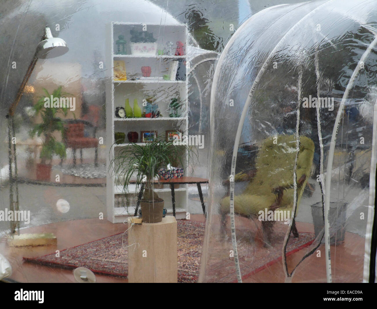 Symbolic plastic privacy bubbles are set up in Madison Square in New York on Wednesday, November 5, 2014 to promote - Stock Image