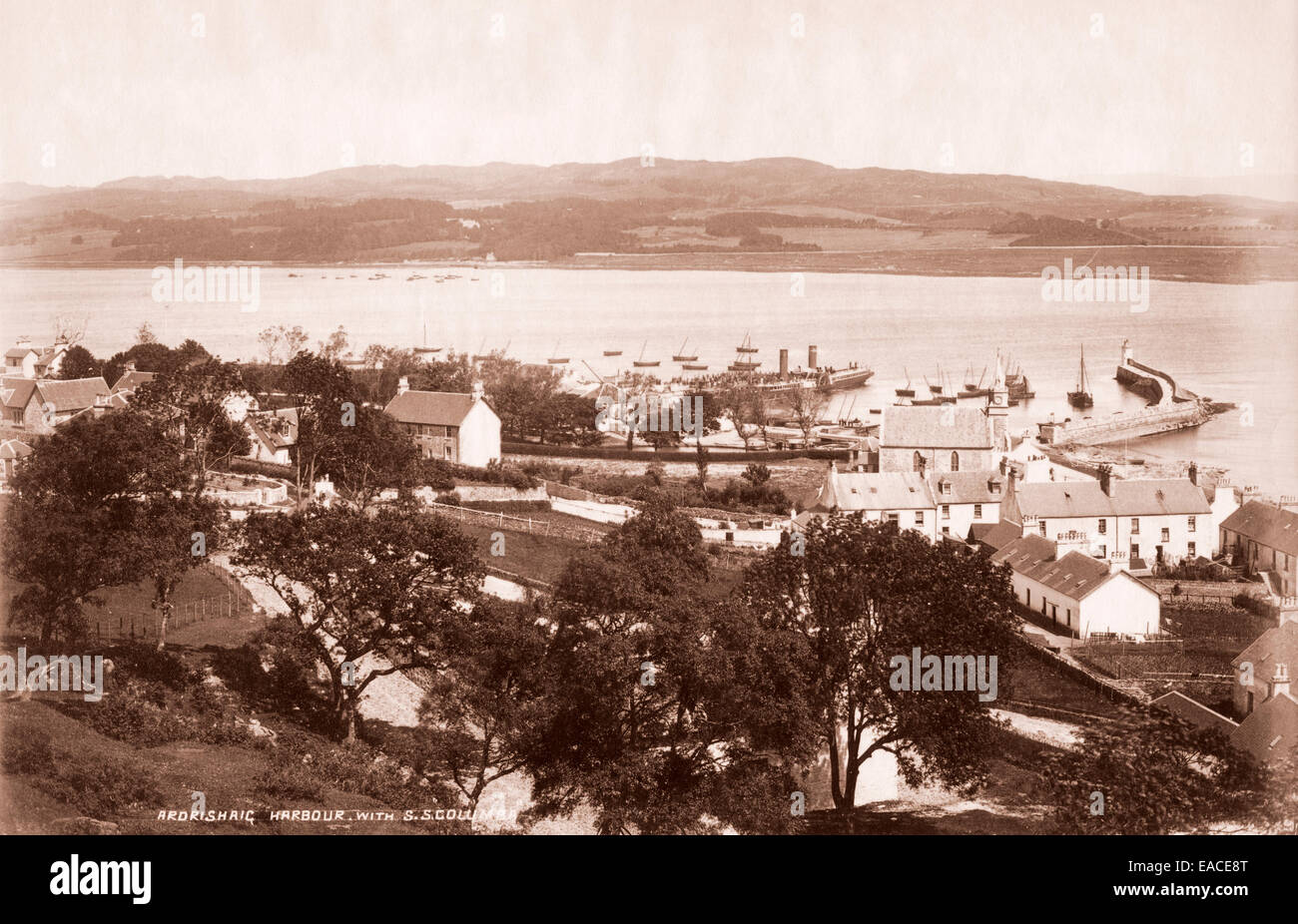 Ardrishaig harbour at the end of the Crinan Canal with SS Collumba in harbour at pier, about 1895, Scotland Stock Photo