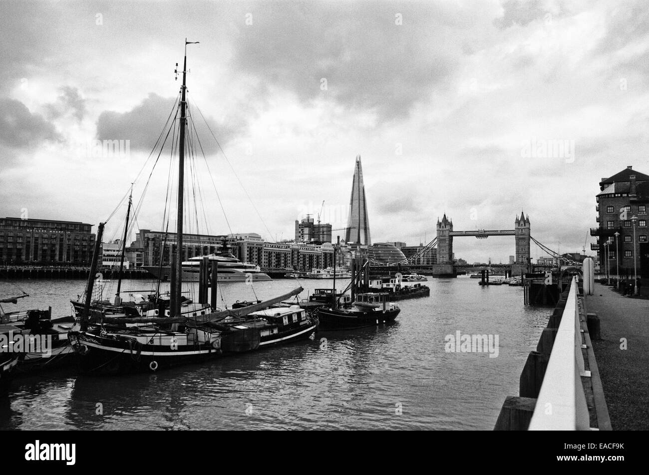 The River Thames London UK at Wapping, looking towards Tower Bridge - Stock Image
