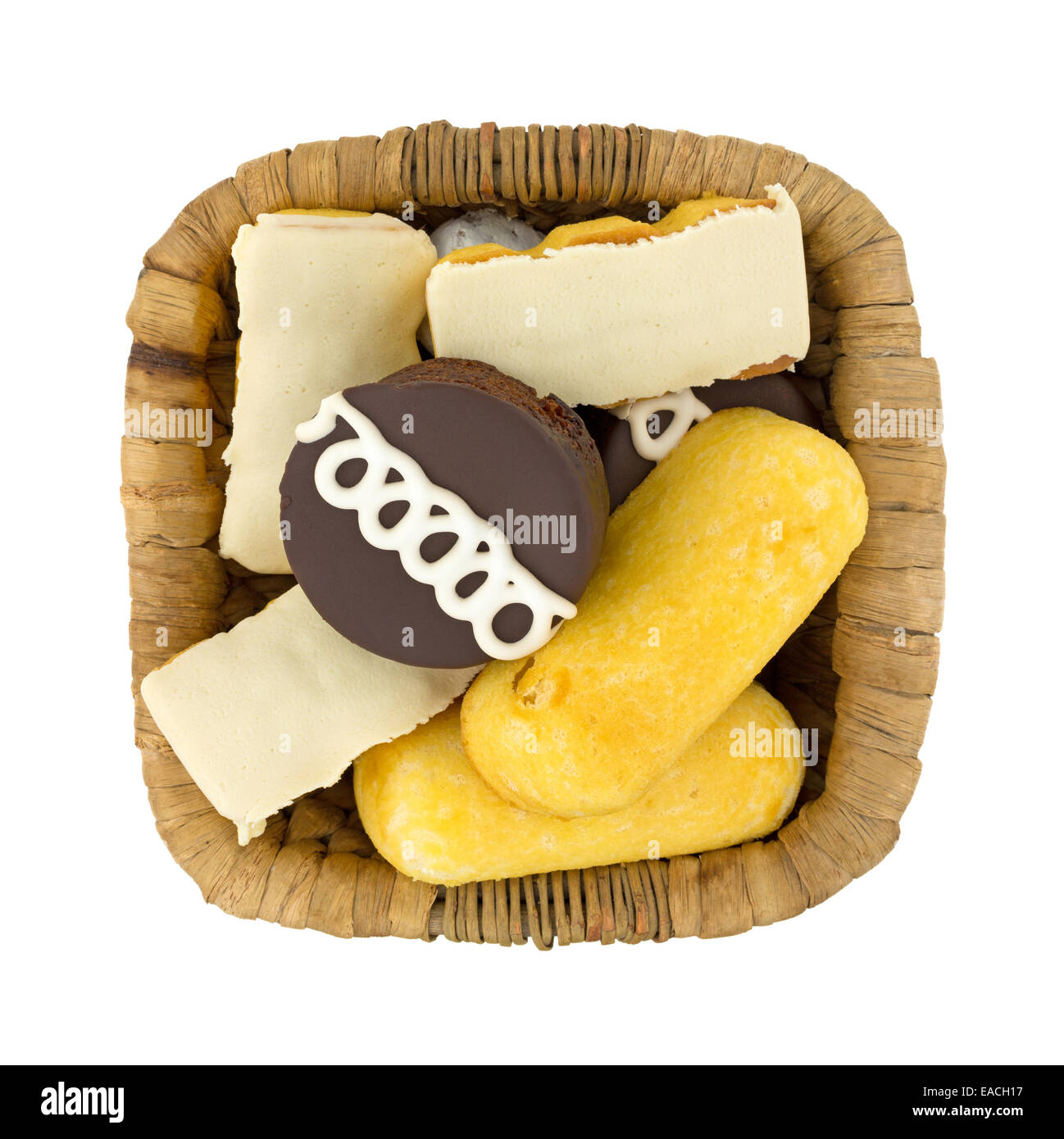 Top view of junk food including powdered donuts, cream filled cakes, chocolate iced cakes and iced covered cakes Stock Photo