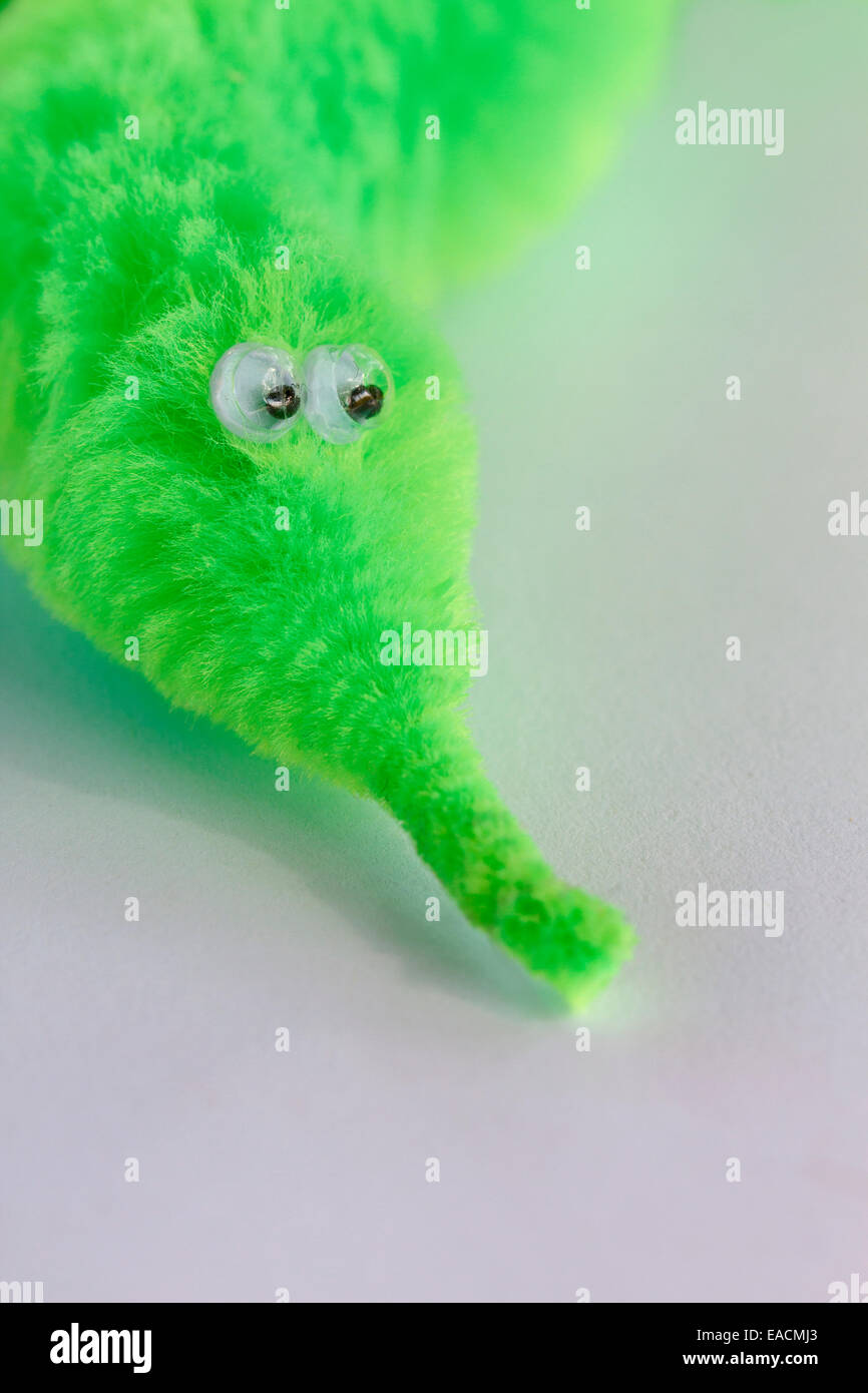 green worm toy - Stock Image