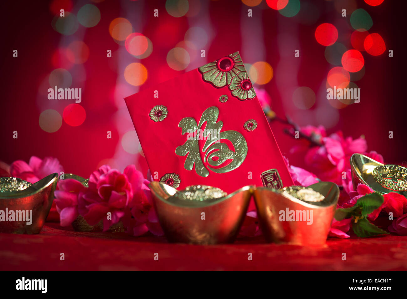 chinese new year festival decorations ang pow or red packet and gold ingots chinese character means fortune or good luck