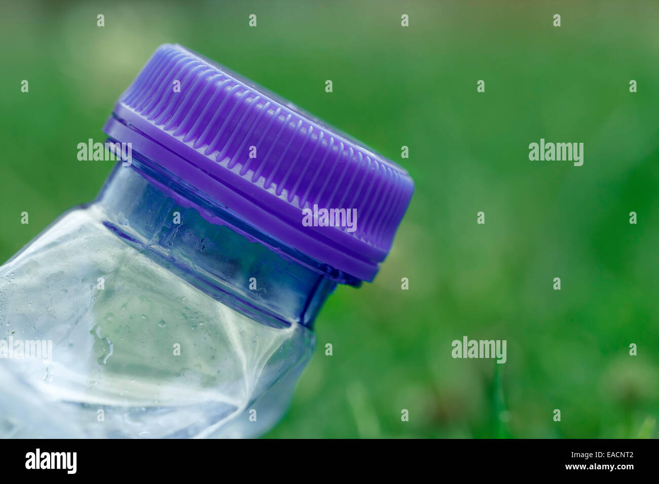 bottle of water compressed, plastic bottle cap, macro shot - Stock Image