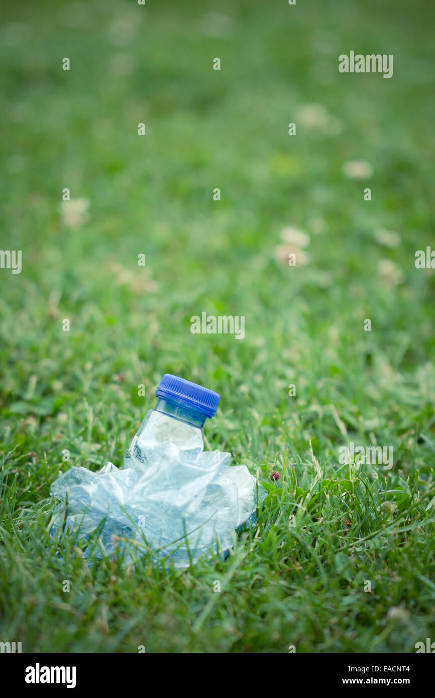 plastic bottle of water compressed, crushed - Stock Image