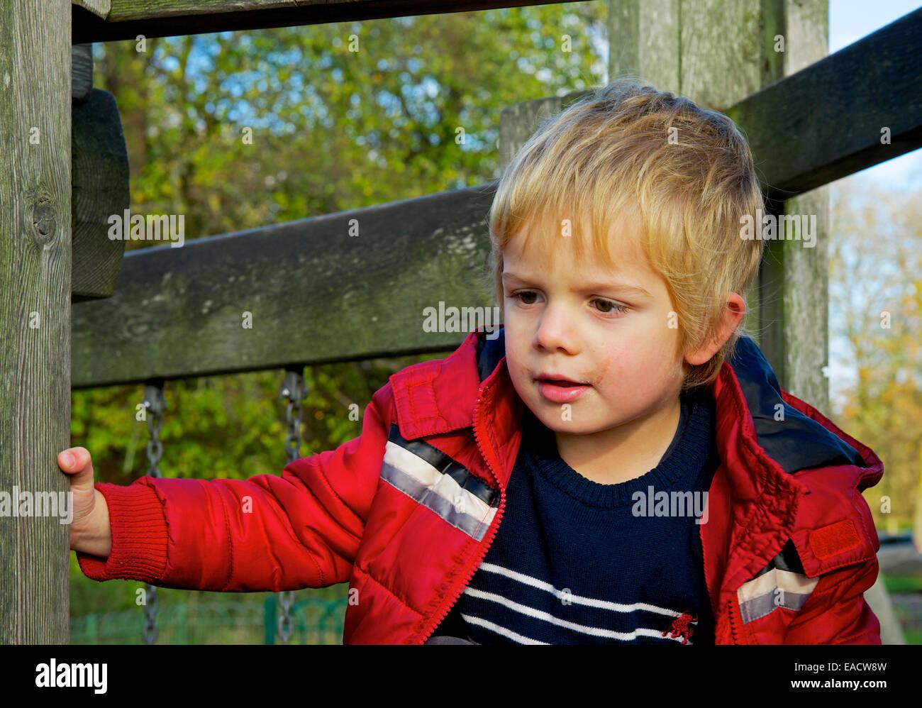 Three-year-old boy in playground Stock Photo