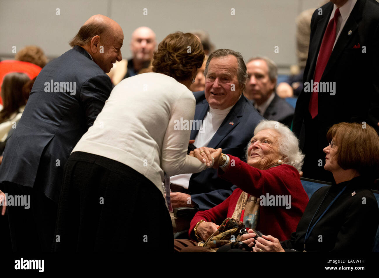 College Station, Texas, USA. 11th November, 2014. Former U.S. President George H. W. Bush greets guests while sitting - Stock Image