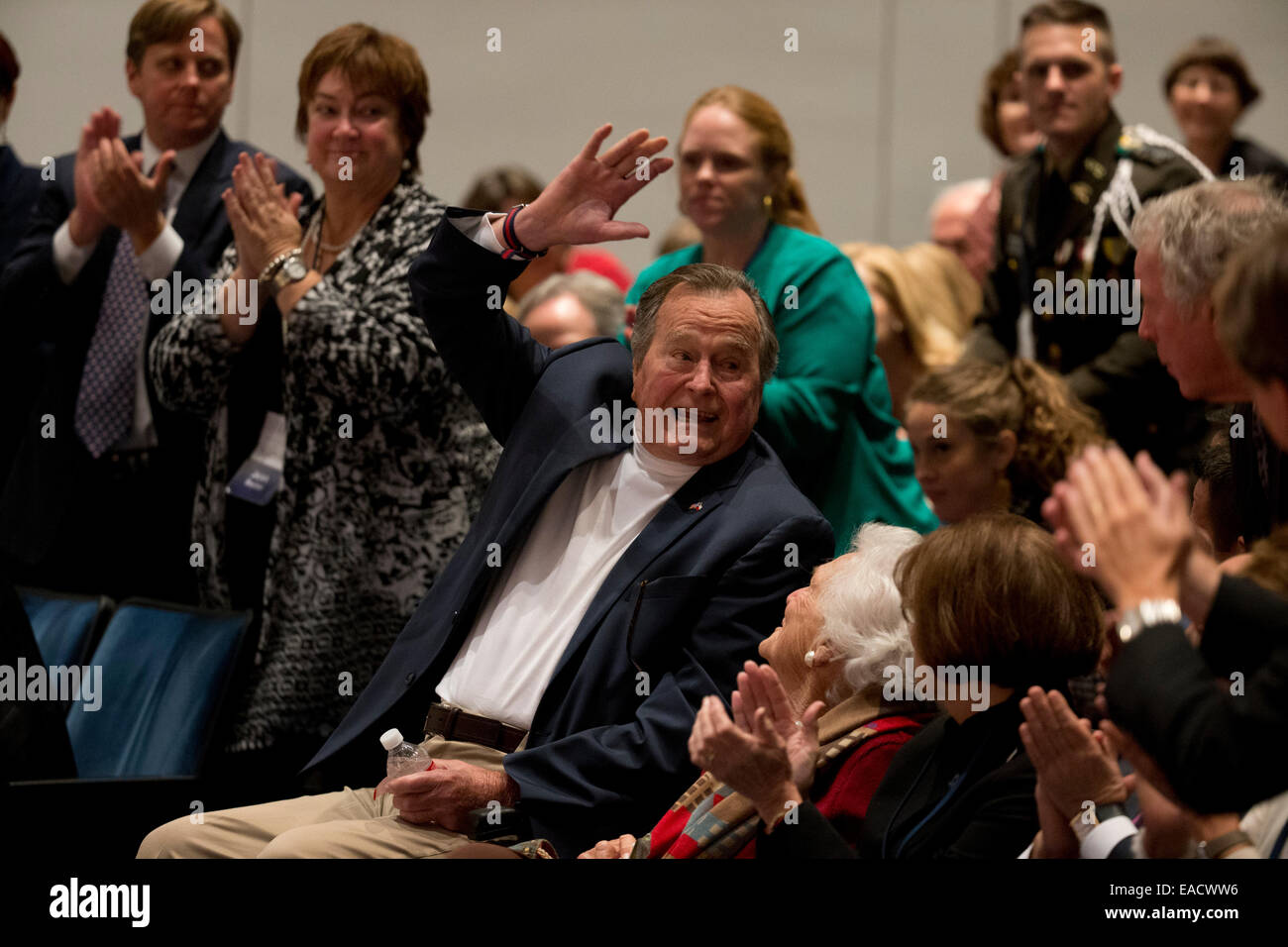 """College Station, Texas, USA. 11th November, 2014. Former U.S. President George H. W. Bush listens with his wife Barbara Bush as his son former President George W. Bush talks about his new book, """"41_A Portrait of My Father""""  during a book event at the Bush Library at Texas A&M University. Credit:  Bob Daemmrich/Alamy Live News Stock Photo"""