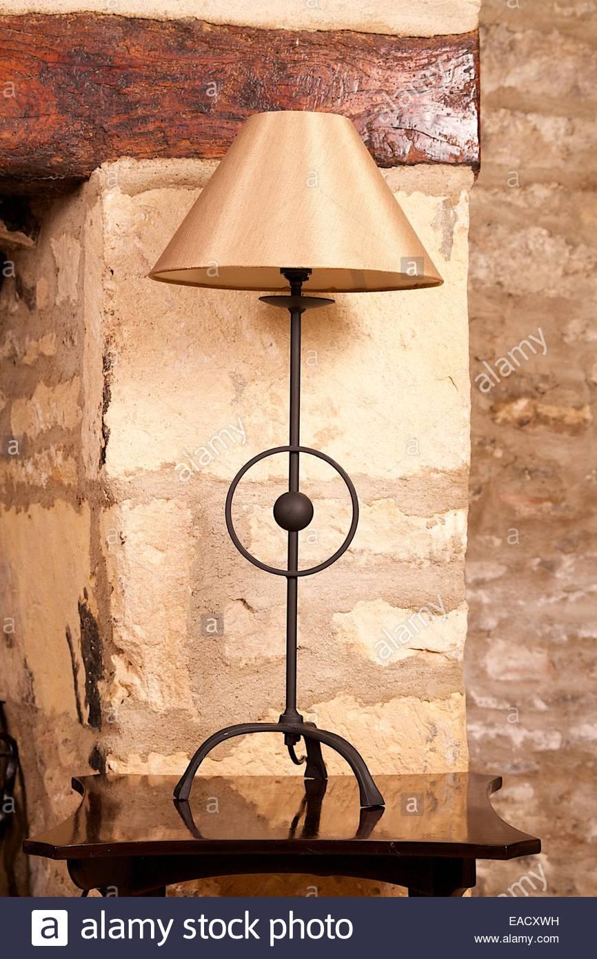 wrought iron lamp, cotswold stone - Stock Image