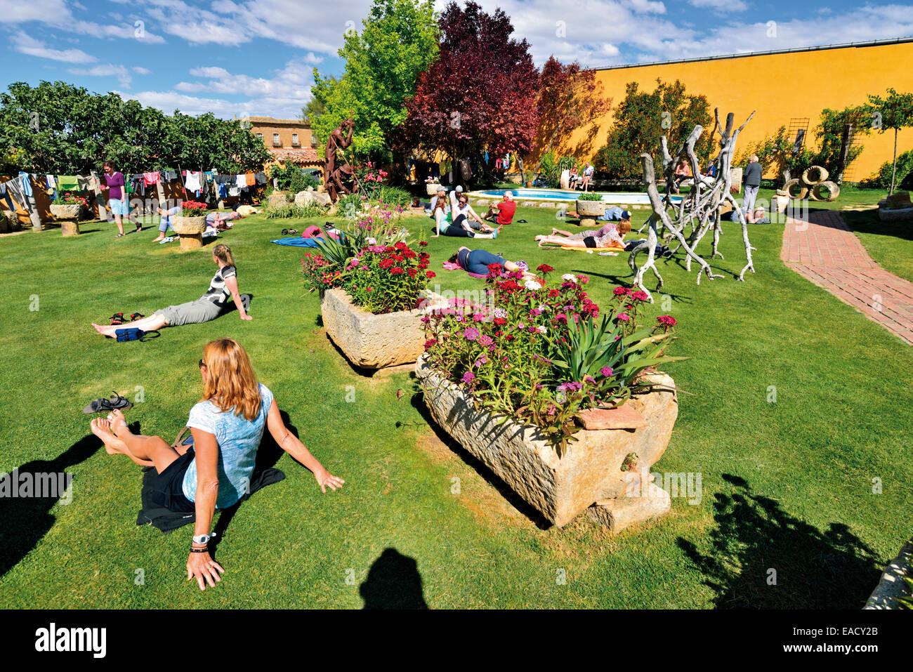 Spain, St. James Way: Pilgrims resting in the  hostel Albergue El Camino in Boadilla del Camino - Stock Image