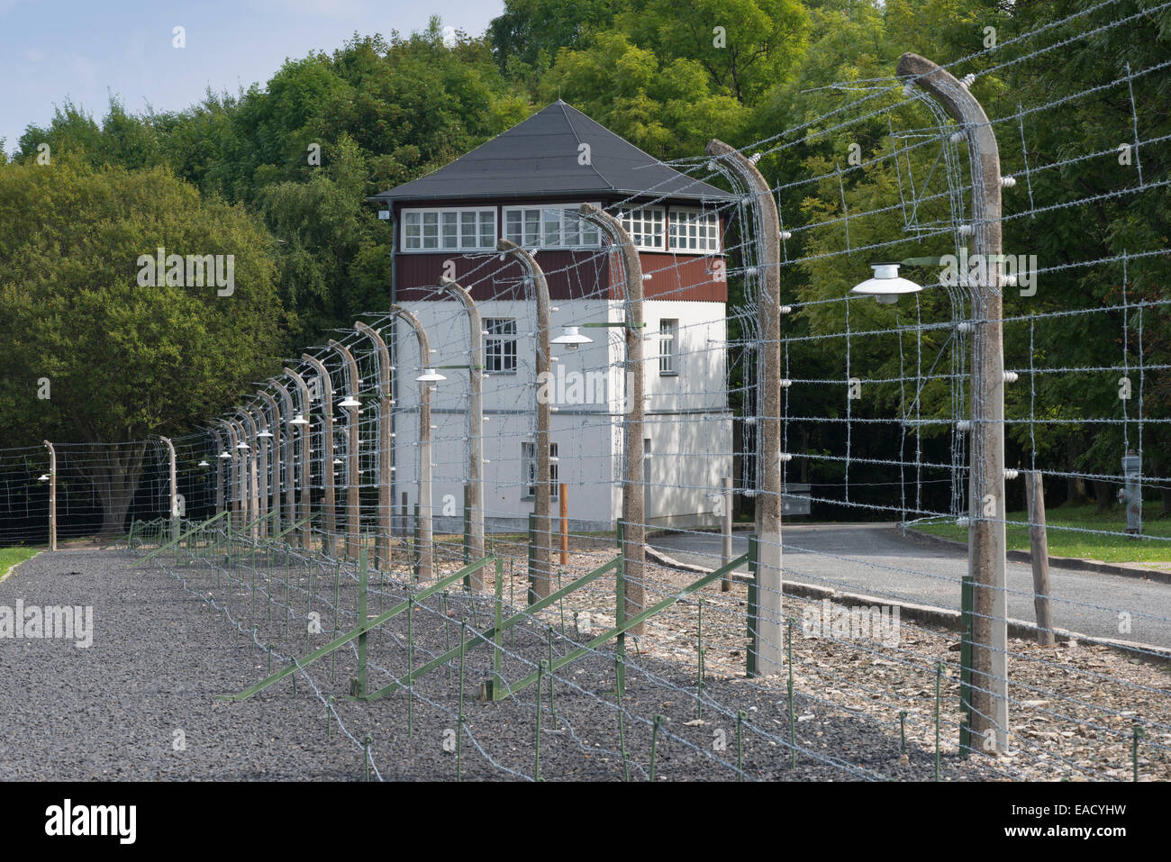 Reconstructed camp fence with watchtower, Buchenwald concentration camp, Weimar, Thuringia, Germany - Stock Image