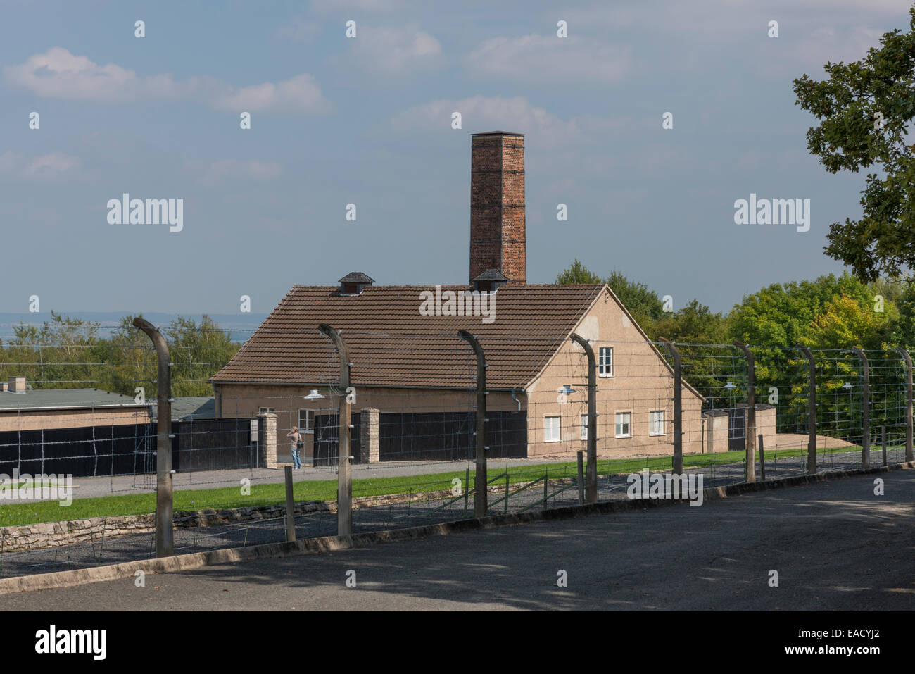 Crematorium and reconstructed fence, Buchenwald concentration camp, Weimar, Thuringia, Germany - Stock Image