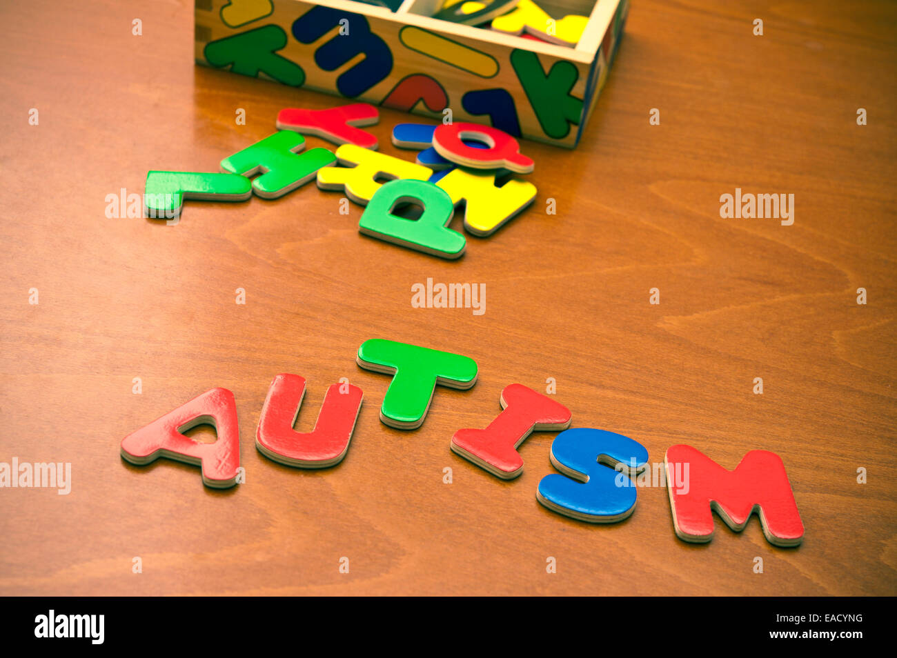 word autism written with colorful kids magnetic letters - Stock Image
