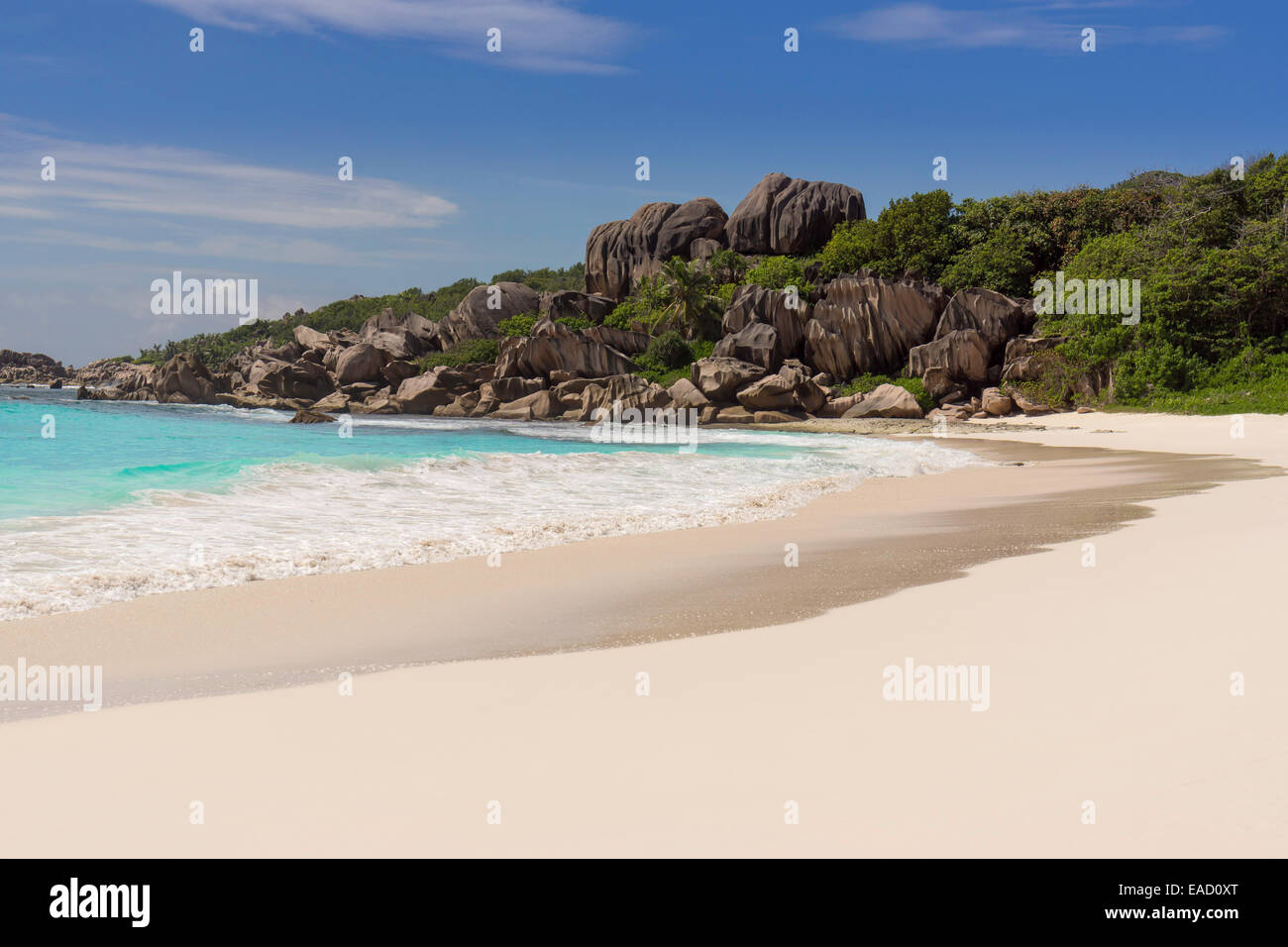 Sandy beach with the rock formations typical for the Seychelles, Grand Anse, La Digue, Seychelles - Stock Image