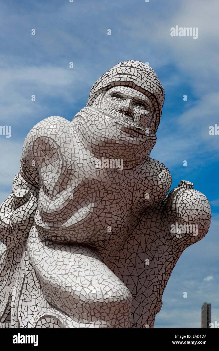 Captain Scott statue depicting him wrapped in warm clothing for the Terra Nova expedition Cardiff Bay, Cardiff, - Stock Image