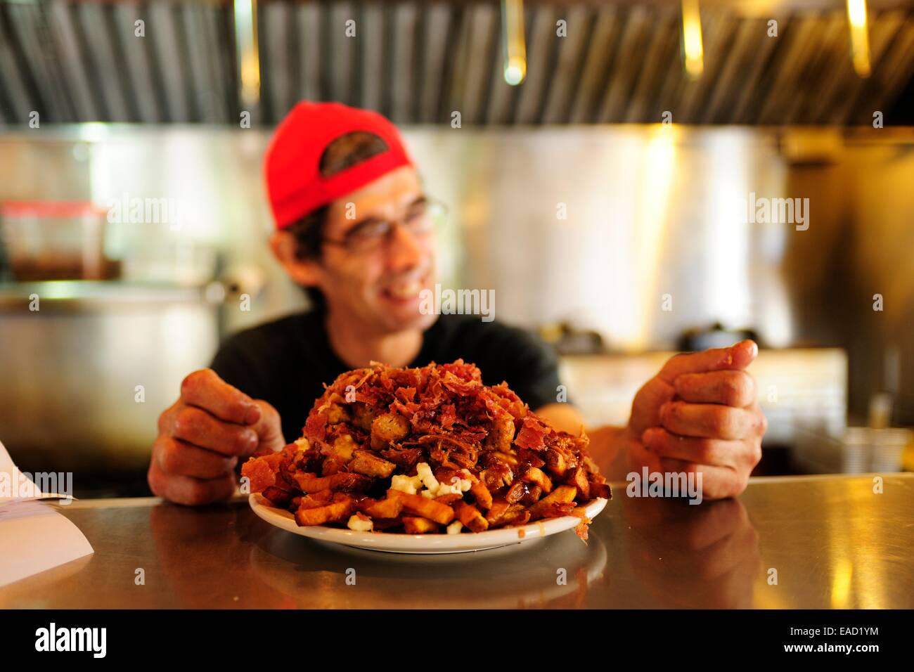 Poutine, a Canadian fast food specialty, Quebec Province, Canada - Stock Image