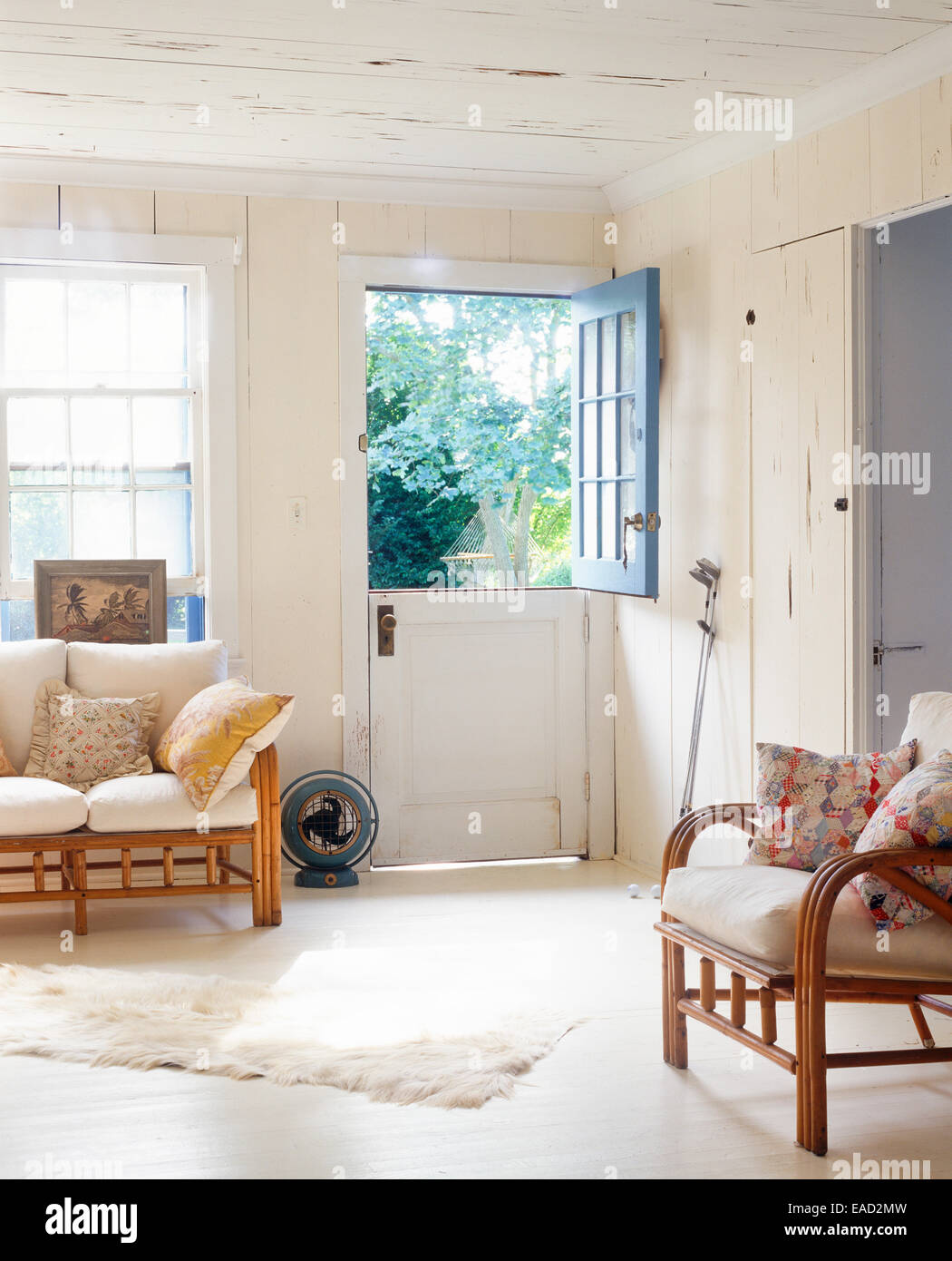 interior of country cottage with partitioned door - Stock Image