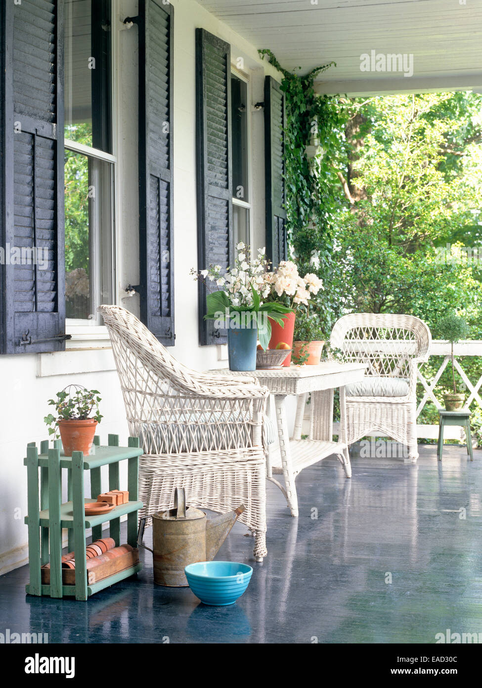 summer porch with wicker furniture and flowers - Stock Image