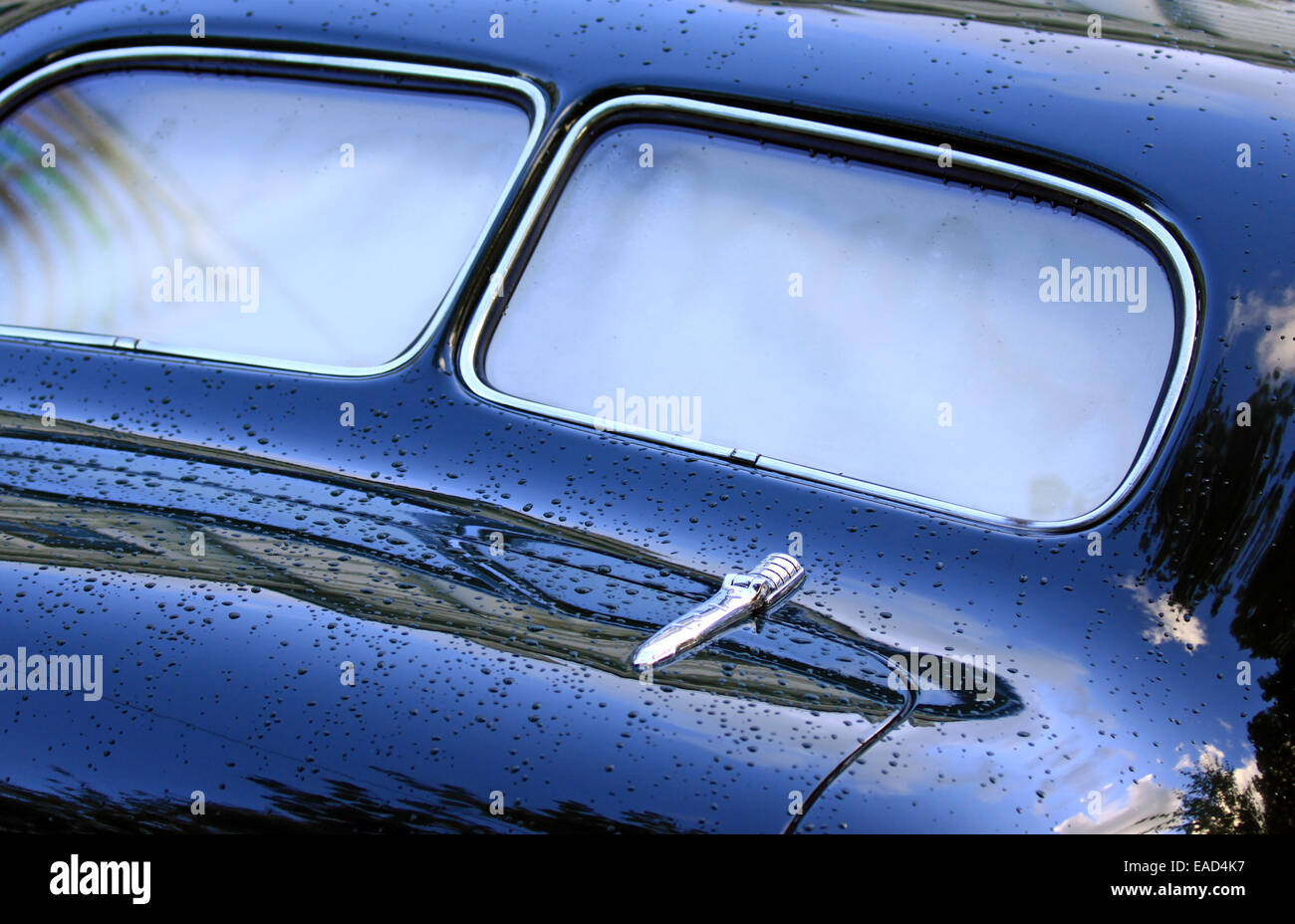 Rear window view of blue vintage car - Stock Image