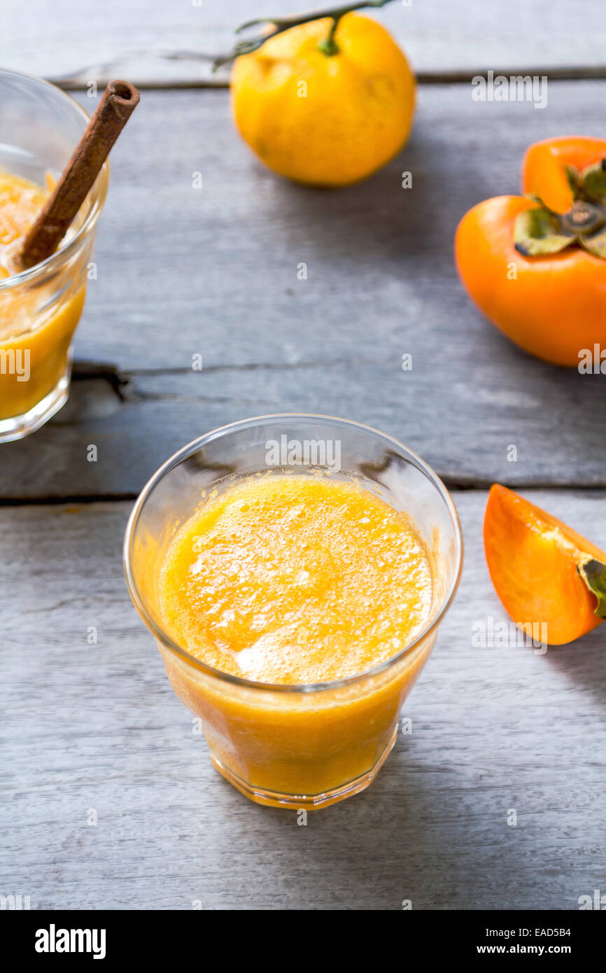 Persimmon with orange smoothie by fresh ingredients - Stock Image