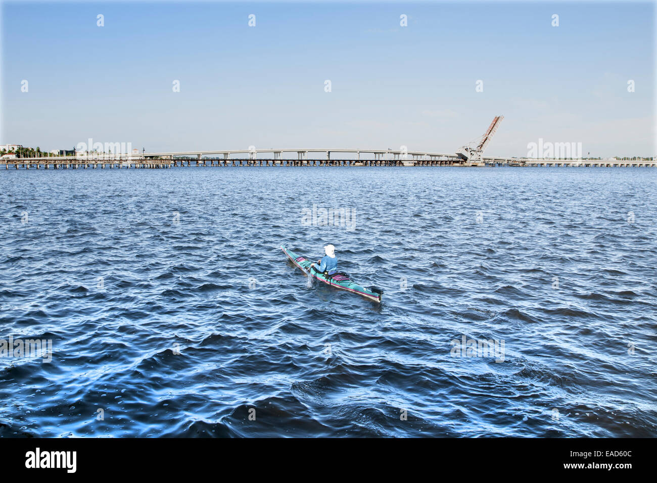 Unrecognizable man in a kayak paddling in the Manatee River, Bradenton, Florida - Stock Image