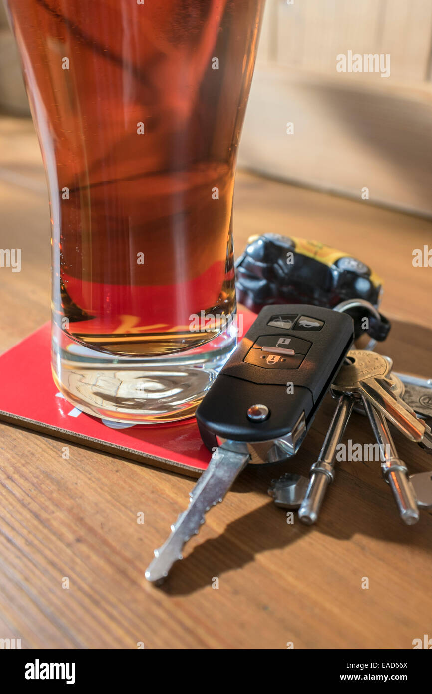 Car keys and a pint of beer. - Stock Image