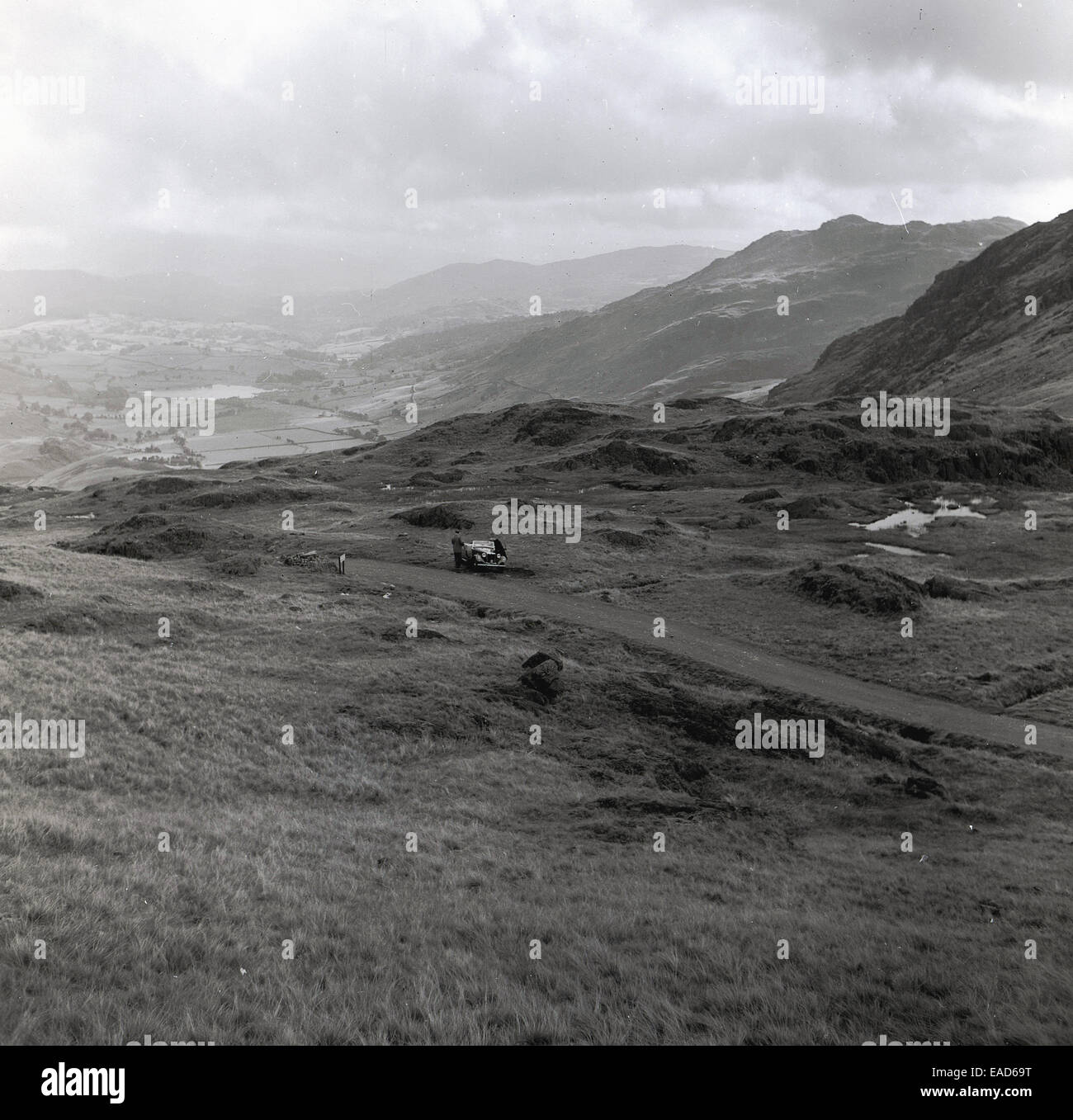 1950s, historical, car parked in the scottish highlands - Stock Image