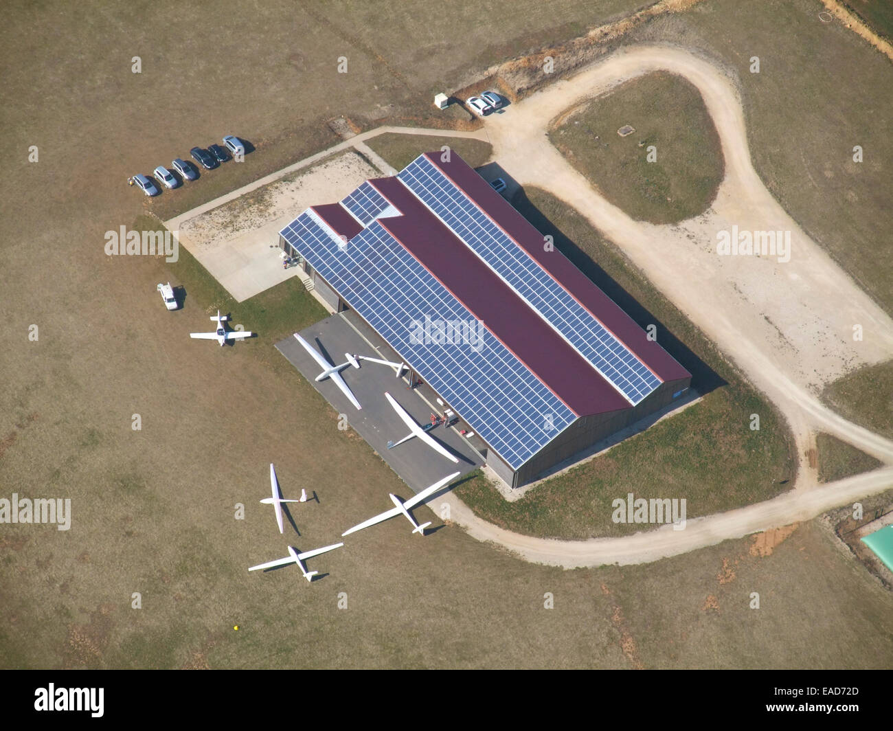 Aerial view of gliders hangar with photovoltaic panels on roof, Pont Saint Vincent aerodrome, Meurthe et Moselle, Stock Photo